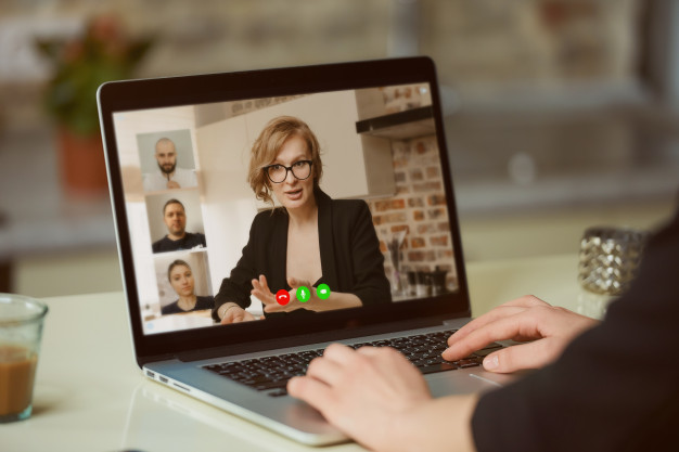 Supervisor in virtual meeting with remote team